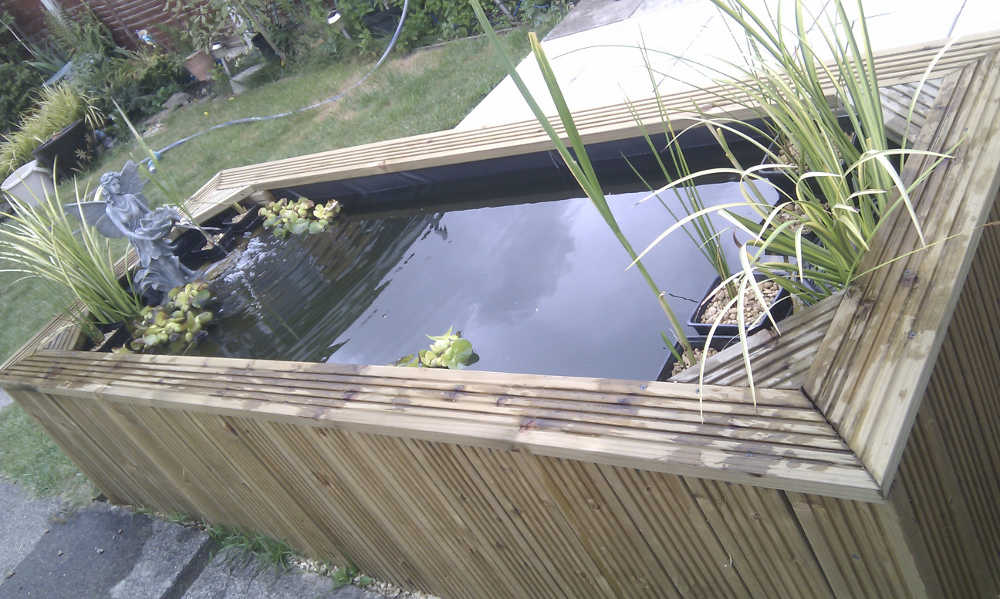 Elevated diy pond using plastic liner and decking board uk for Garden decking with pond